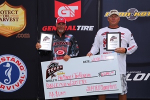 First-place finishers Tim Reneau (left) and Phil Marks (right) hold up their plaques and check at the TXTT Championship Event at Toledo Bend on June 7.